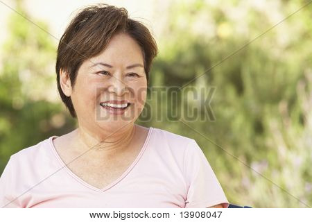 Smiling Senior Woman In Garden