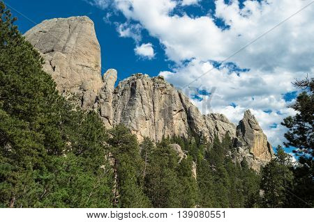 Tall granite formations framed by Ponderosa Pines.