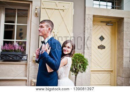 Wedding couple near vintage building at wedding