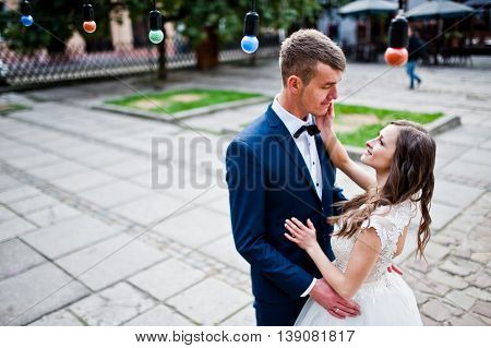 Wedding couple near colored light outdoor at wedding