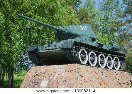 NOVGOROD REGION, RUSSIA - JUNE 02, 2016: Tank T-34-85 closeup. The monument at the entrance to the city of Staraya Russa. Historical landmark