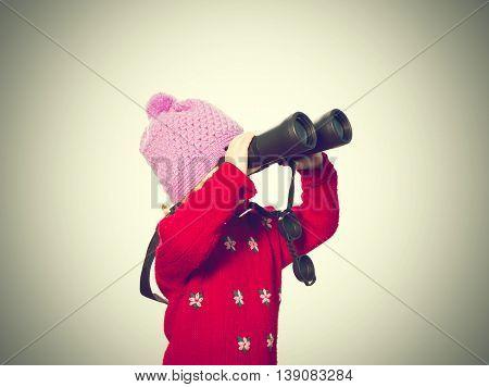 Little Girl  Looks Through Binoculars.