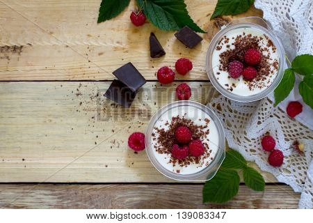 Homemade Chocolate Mousse With Raspberries On A Table In A Rustic Style, Top View.