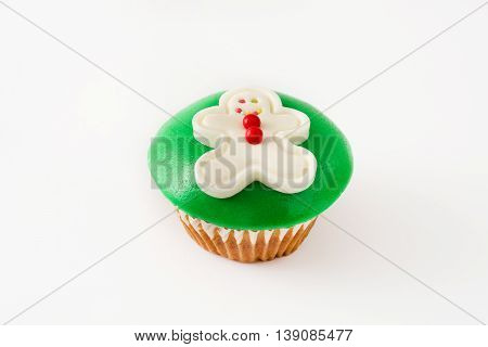 Christmas gingerbread man cupcake isolated on white background