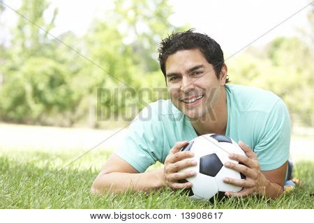 Portrait Of Young Man In Park With Soccer Ball