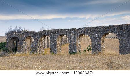 roman aqueduct ruins in monte romano italy