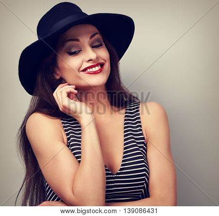 Happy Thinking Makeup Lady In Fashion Hat Looking Down. Toned Closeup Portrait