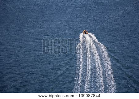 Trail on sea surface behind of speed boats