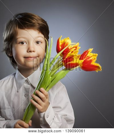 cheerful kid with a bouquet of tulips