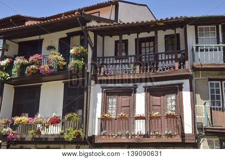 Picturesque balconies of traditional houses of the historical center of Guimaraes Portugal.