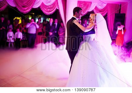 Amazing First Wedding Dance Of Newlyweds On Low Pink Light And Heavy Smoke