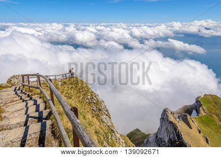 The Swiss Alps from the Pilatus Peak. Top trail with steps and wooden rails.