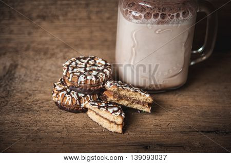 Cookies with chocolate and a bottle of warm cocoa. Autumn background