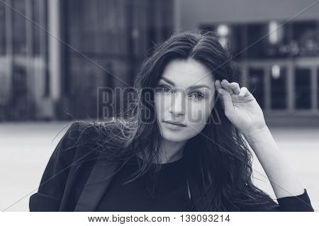 Portrait of a gorgeous young brunette posing in an urban context
