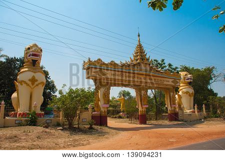 The Input Gate. Mya Tha Lyaung Reclining Buddha. Sculptures Of Mythological Animals At The Entrance.