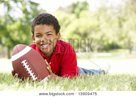 Boy In Park With American Football