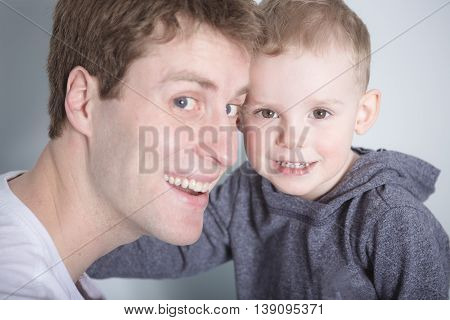 A Son with father forehead to at home bed