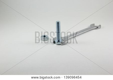 Spanners bolt and nut on a white background