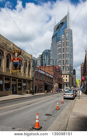 NASHVILLE, TN - JUNE 5: A view of 3rd Ave South in downtown Nashville, TN. The Johnny Cash Museum and the AT&T tower are major landmarks located along this avenue.