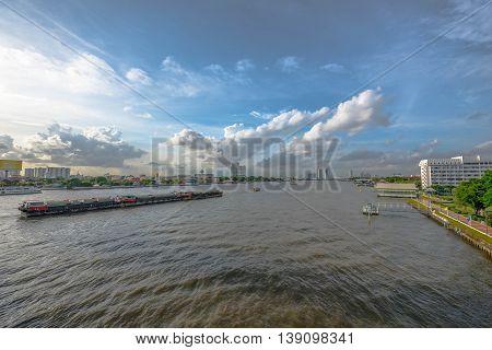 Tugboat towing freighter in Chao Praya River - Bangkok Thailand