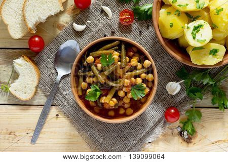 Vegetarian Vegetable Stew With Chickpeas And Green Beans On A Rustic Background. Top View . Healthy