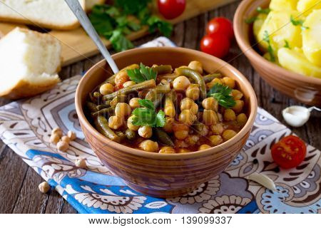 Healthy Eating, Diet, Vegetarian Cuisine And Cooking Concept - Stewed Chickpeas With Tomatoes, Garli