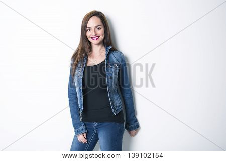 A Body Shot of a Cheerful Woman in Denim jacket
