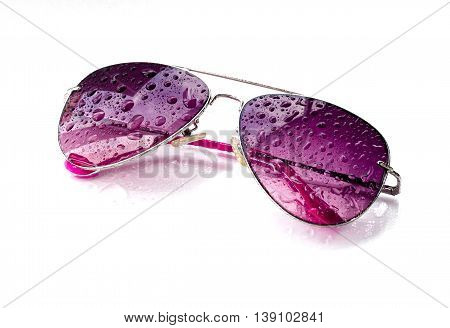 pink sunglasses and drops on an isolated white background