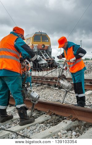 Tobolsk, Russia - July 15. 2016: Sibur company. Denisovka railway station. Railway workers repairing rail