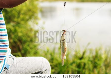 Boy caught a fish. child on the lake fishing