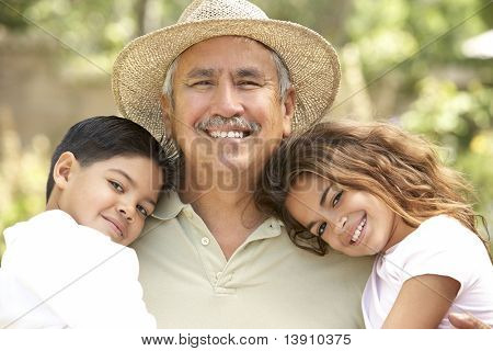 Grandfather With Grandchildren In Garden