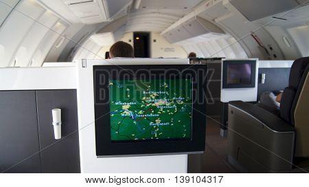 FRANKFURT - SEPTEMBER 2014: Traveling Lufthansa First Class in a Boeing 747-400 Upper Deck - inflight entertainment