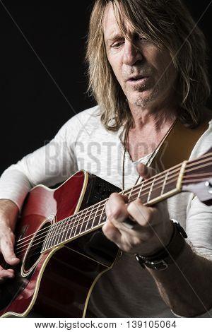 A nice musician play guitar on studio