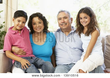 Grandparents With Grandchildren Relaxing At Home Together
