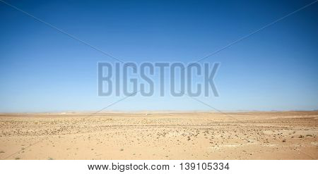 Rocky desert at the beginning of Sahara in the middle of Tunisia.