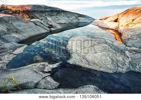 Pool in rocks on the shore of island
