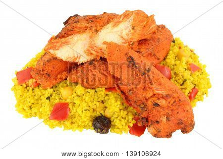 Tandoori chicken pieces with couscous isolated on a white background