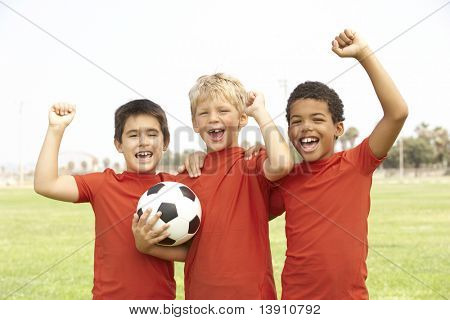 Young Boys In Football Team Celebrating