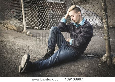 A Sorrowful young adult on the City Street