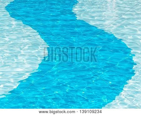 Blue deep strip going through a crystal clear swimming pool ideal for copy space and posters