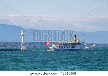 Geneva Switzerland - July 15 2016: The Savoie passenger steamboat leaving the city of Geneva Switzerland.