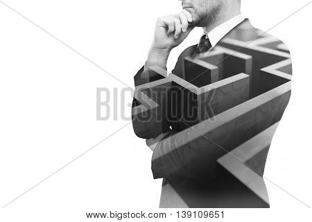 Young businessperson thinking about ways to overcome business obstacle. Isolated on white background with maze and copy space. Double exposure