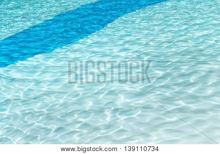 clear swimming pool background with sun reflection ripples in a two tone blue solid curve patten darker strip across the corner ideal for ad poster copy space or text