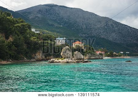 Urban Landscape And The Sea At Sunset In Fiscardo, Kefalonia, Greece