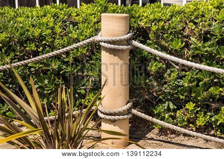 post of rope fence with knots horizontal background