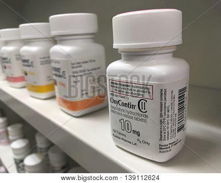 Ogden Utah- July 16, 2016: oxycontin bottle on pharmacy shelf