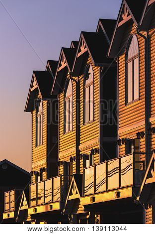 Evening sun shining on a row of townhouses or condo