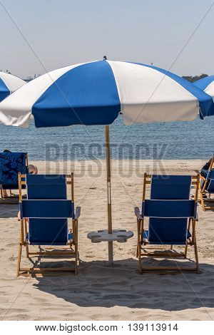 Parasols And Beach Chairs At  Sunny Sandy Beach