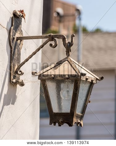 Old Street Light Fixture Mounted On A Wall White With Decorative Details