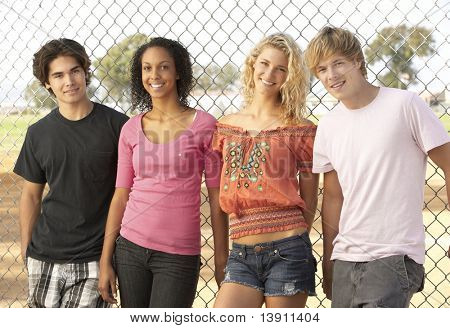 Diverse Group Of Teenagers Standing In Playground